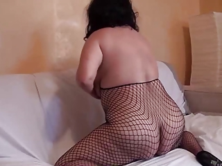 Alluring saggy lady in fishnets