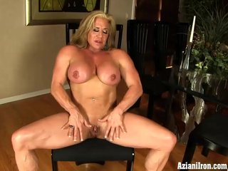 Wanda Moore Female bodybuilder pulls her hood back to expose her big clit