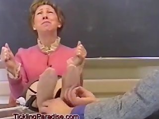 granny teacher tickled on the school