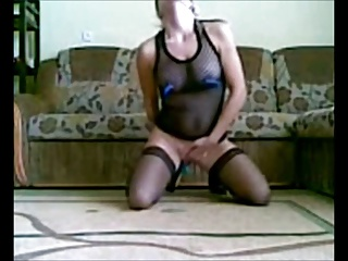 Mature woman masturbates with a bottle