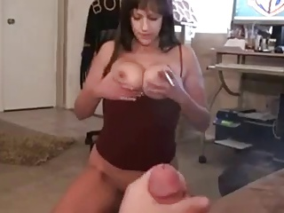 Busty mom smoking cigarette and sucking cock