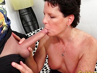 Petite Tittied Mature whore Beth McKenna deep-throats and pokes a lengthy salami