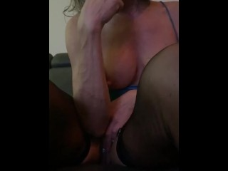 Middle aged cougar dips her lollipop in her pussy and ass