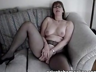 Horny granny fingering on the couch