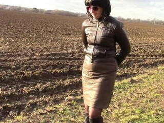 Pissing in a chocolate-colored leather micro-skirt and cuffs