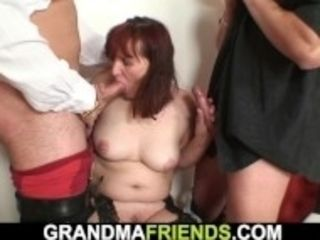 """""""Redhead granny in stockings double fucked on the table"""""""