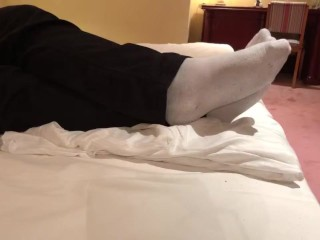 Male dress shoes, nikes, globes and white socks shoeplay in a nice hotel