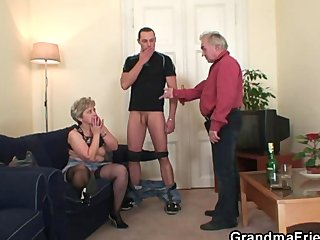 Grandma in black stockings sucks and rides