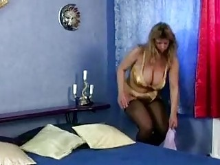Busty mature woman rubbing her pussy