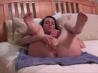 Naked MILF with big tits and lovely feet toying herself in bed