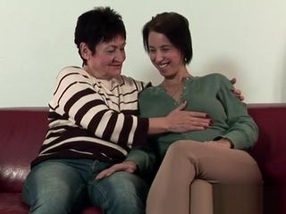 Lesbian granny scissoring with busty amateur