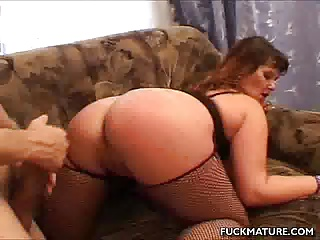 Sandwiched Mature In A Threesome