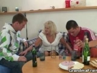 """Partying fellows seduce elderly blond into threesome"""