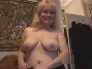 Mature buxomy blond stunner in stocking and mini micro-skirt striptease