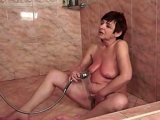 Horny granny sucking and riding young cock