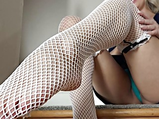 Blonde maid with white fishnet stockings shows off mature pussy