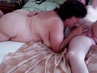 Mature BBW DW enjoys big cock at the GangBang