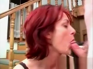Messy red-haired cougar blows wood