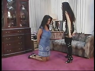 Submissive brunette holds up her tits with her mouth with clip