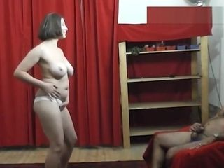 Big-boobed cougar dances and does striptease flash