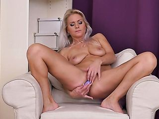 Bosomy super-sexy blond cougar Kathy Anderson is all alone and she heads solo