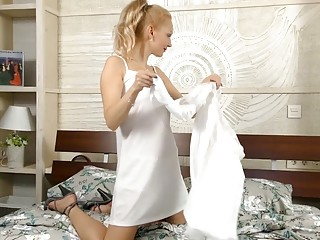 Mature blonde with natural hairy pussy masturbates in bed here