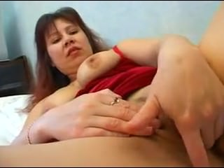 Aunt indulges himself in bed sex toys