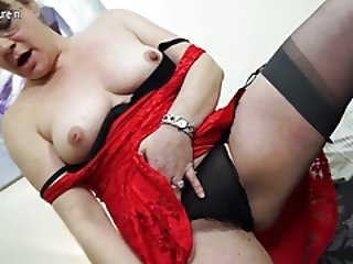 British mother masturbating on her bed with toys