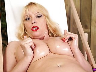 Buxom alone mature gal Lucy Gresty plays with her saggy funbags