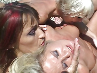 Hot and horny lesbians get dildo and share sucking it